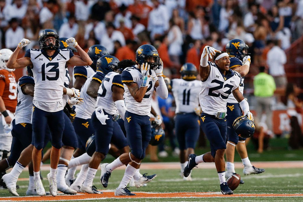 AUSTIN, TX - NOVEMBER 03:  The West Virginia Mountaineers celebrate after winning the game against the Texas Longhorns at Darrell K Royal-Texas Memorial Stadium on November 3, 2018 in Austin, Texas.  (Photo by Tim Warner/Getty Images)