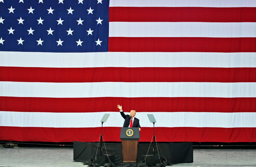 President Donald Trump waves as he addresses the scouts at the 2017 National Boy Scout Jamboree at the Summit in Glen Jean, W.Va., Monday, July 24, 2017. (AP Photo/Steve Helber)