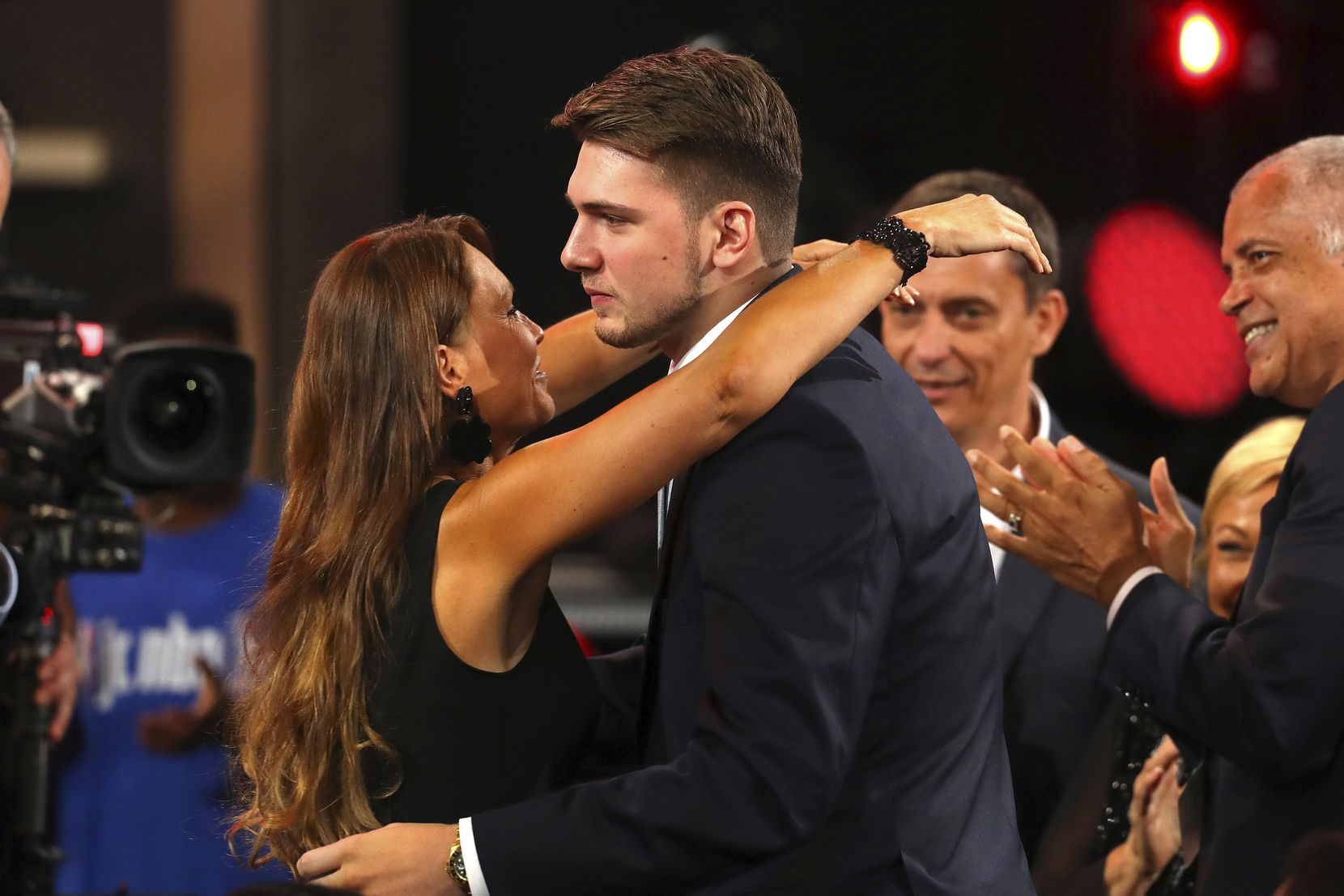 NEW YORK, NY - JUNE 21:  Luka Doncic hugs his mother, Mirjam Poterbin, after being drafted third overall by the Atlanta Hawks during the 2018 NBA Draft at the Barclays Center on June 21, 2018 in the Brooklyn borough of New York City. (Photo by Mike Stobe/Getty Images)