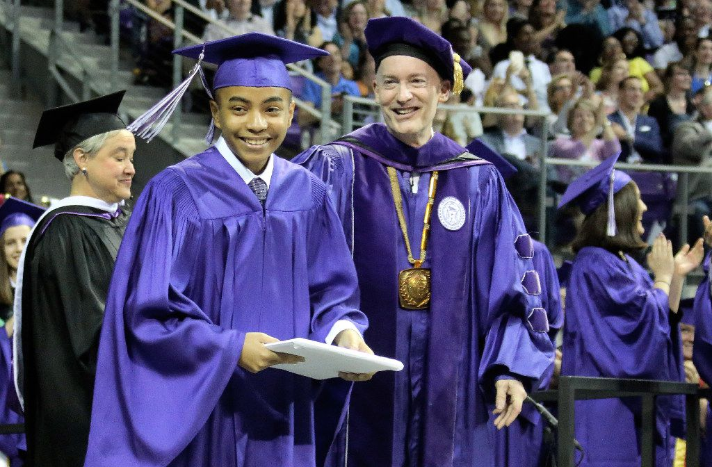 14-year-old Carson Huey-You receives a bachelor's degree in physics at the TCU commencement, as Chancellor Dr. Victor J. Boschini, Jr., center right, does the honors at the event. (Louis DeLuca/Dallas Morning News)
