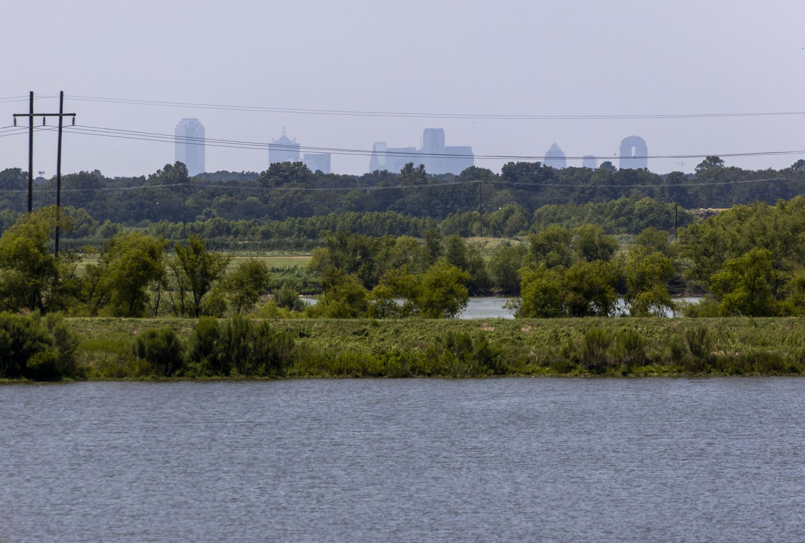 The downtown Dallas skyline is visible from the levee at Dallas Water Utilities' Southside Wastewater Treatment Plant, which sits a few miles from Sandbranch.