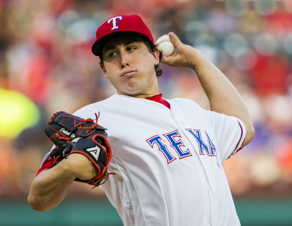 Texas Rangers starting pitcher Derek Holland (45) pitches during the first inning of their game against the Los Angeles Angels on Monday, May 23, 2016 at Globe Life Park in Arlington, Texas.   (Ashley Landis/The Dallas Morning News)