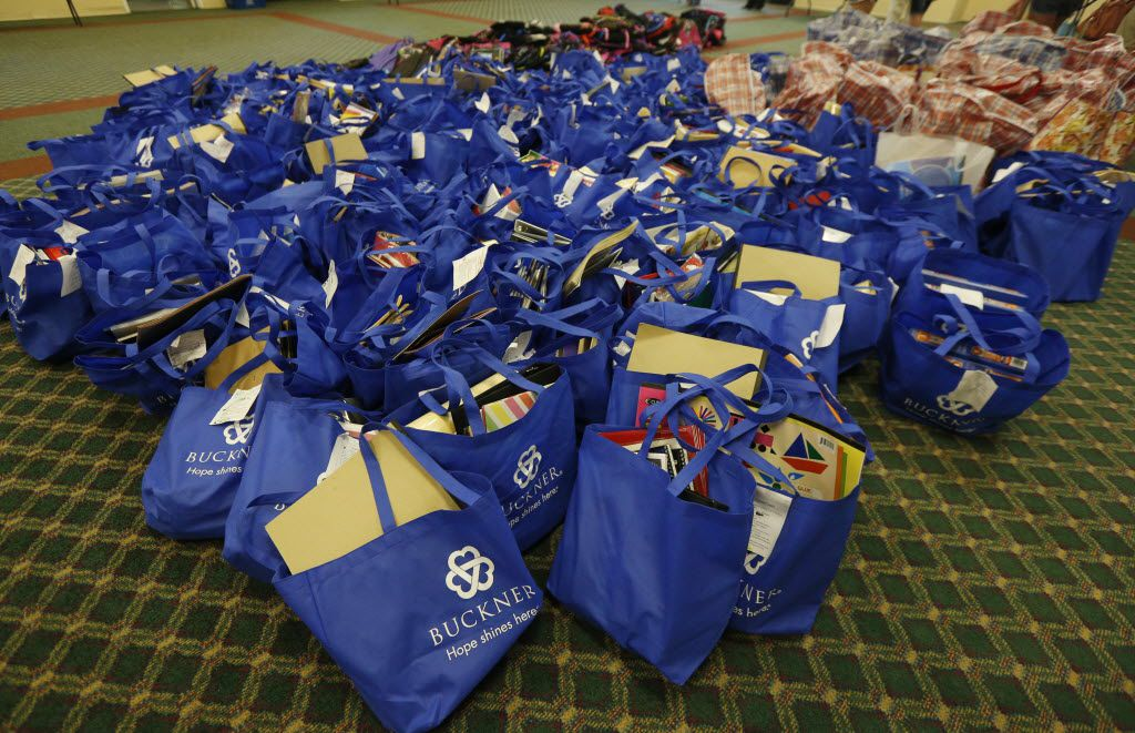 "Scattered efforts to help Texas' abused and neglected children -- such as Buckner International's Back to School Bash (above), which provides school supplies to foster children -- will be expanded and coordinated under first lady Cecilia Abbott and the Department of Family and Protective Services' ""Network of Nurture Initiative"" aimed at churches, synagogues and mosques. (File 2014/Staff)"