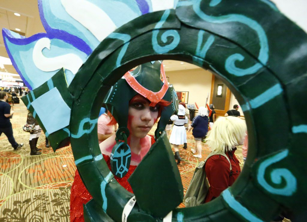 Jonah Longoria from San Antonio, Texas  as Nami from League of legends is framed by the characters weapon at AnimeFest 2015.