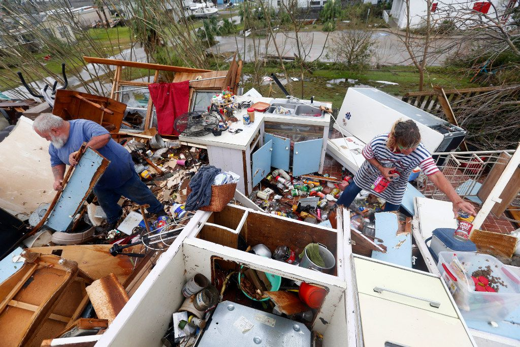 Bill and Paulette Rogers search for his wallet after Hurricane Harvey destroyed their house in Port Aransas, Texas on Aug. 26, 2017.   (Nathan Hunsinger/The Dallas Morning News)