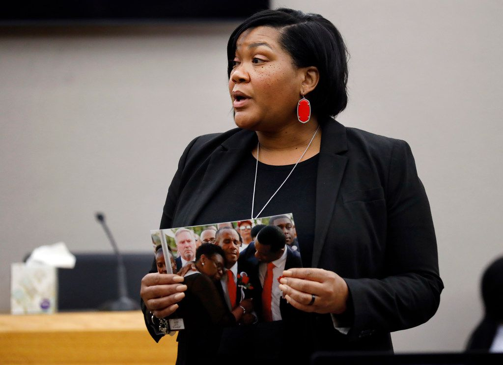 Assistant District Attorney LaQuita Long shows the jury a photo of Botham Jean's parents grieving during closing remarks in the sentencing phase of Amber Guyger's murder trial.