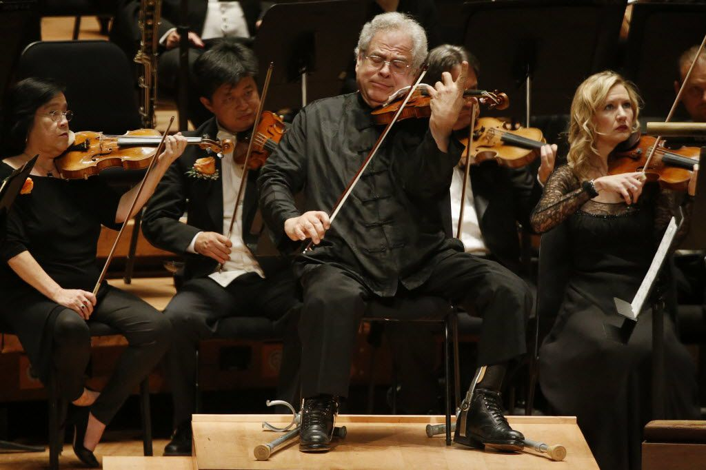 Violin soloist Itzhak Perlman performs with the Dallas Symphony Orchestra  at the Meyerson Symphony Center in 2014