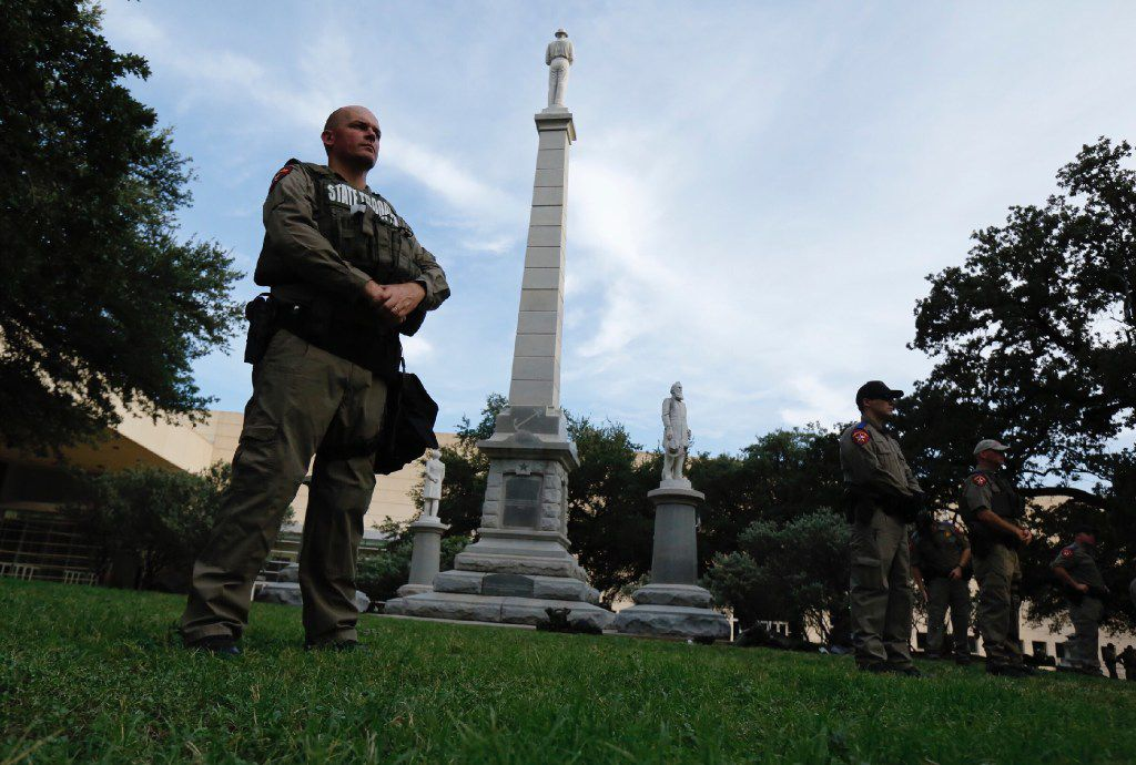 Texas state troopers guard the Confederate War Memorial before the March Against White Supremacy rally at Pioneer Park Cemetery on August 19, 2017.