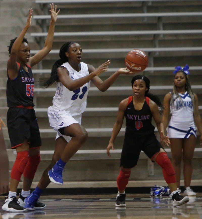 Mansfield Summit center Tommisha Lampkin (23) passes to a teammate as she is surrounded by Dallas Skyline defenders Kyjai Miles (55) and Zyniah Thomas (0) during first half action. The two teams played their Class 6A bi-district girls basketball playoff game at Ellis Davis Field House in Dallas on February 11, 2019. (Steve Hamm/ Special Contributor)