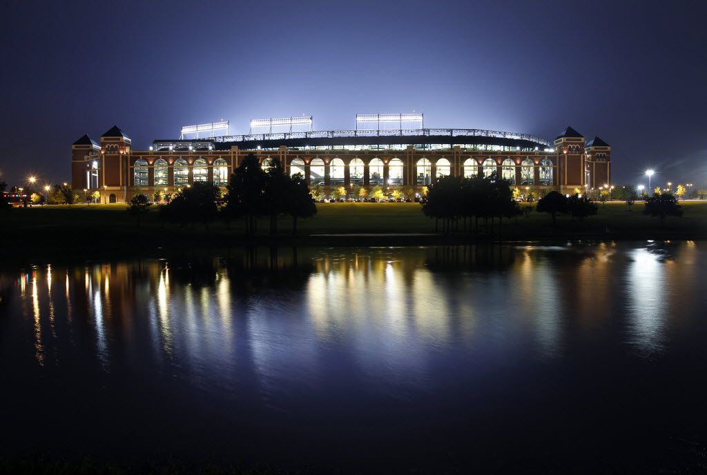 The lights are aglow as the Texas Rangers face the New York Yankees at the Rangers Ballpark in Arlington.  As it stands now, the Rangers would face the Yankees in the playoffs, Friday, September 10, 2010.  (The stadium is reflected in Mark Holtz lake.)  (Tom Fox/The Dallas Morning News)