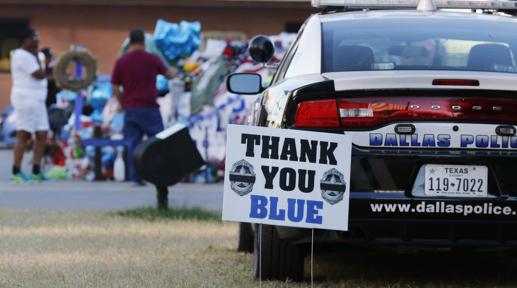 People paid their respects to the five Dallas police officers killed in the July 7 attack. (David Woo/Staff Photographer)