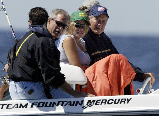 Then-President George W. Bush, his daughter Jenna Bush and former President George H.W. Bush went fishing off Boon Island near Kennebunkport, Maine, on Aug. 8, 2004.