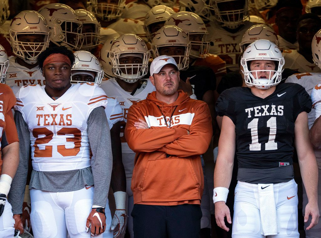 University of Texas linebacker Jeffrey McCulloch (23) and quarterback Sam Ehlinger (11) stand next to Texas head coach, Tom Herman, before the team exits the tunnel for the Orange and White spring game held at Darrel K Royal Texas Memorial Stadium on Saturday, April, 13, 2019, in Austin, Texas.  (Rodolfo Gonzalez/ Special Contributor)
