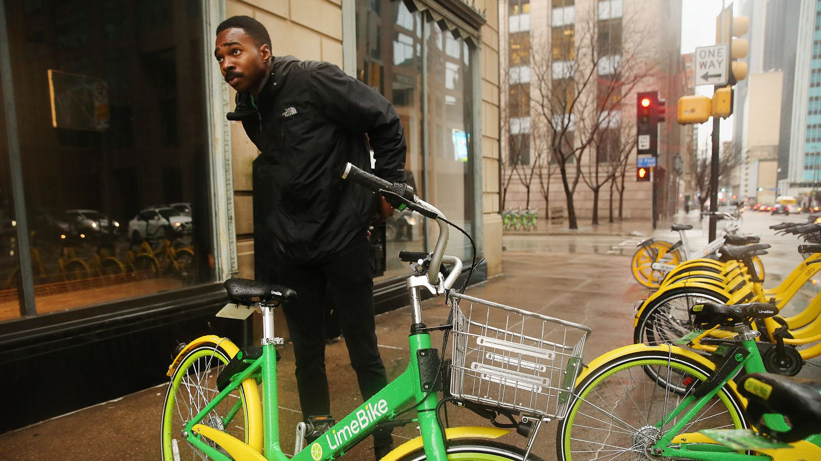 Christian Scull, a lead and operations specialist, rebalances LimeBike bicycles in downtown Dallas on Feb. 28, 2018.