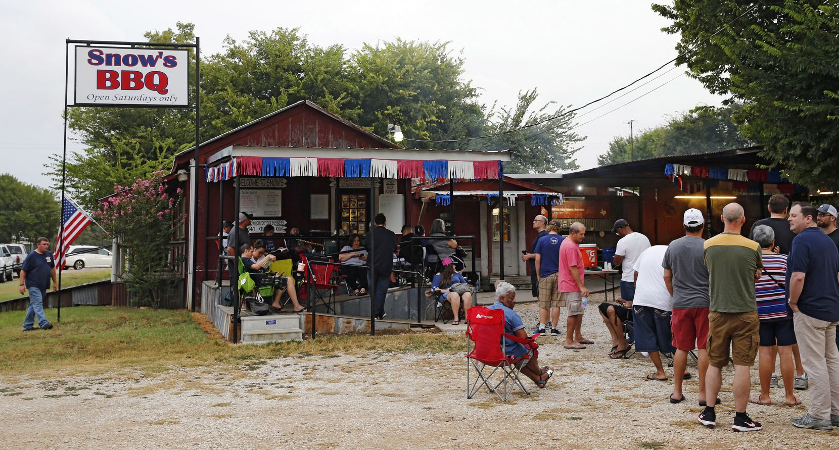 People wait in line for Snow's BBQ to open at 8 a.m.