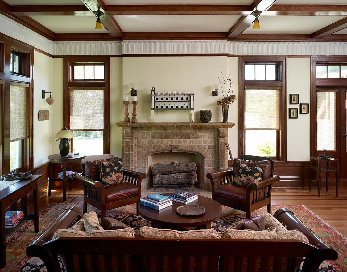 The living room of the Parks Estate is lined with American black walnut. The room's Batchelder tile fireplace is original, with the tiles pressed with intricate nature scenes and landscapes.