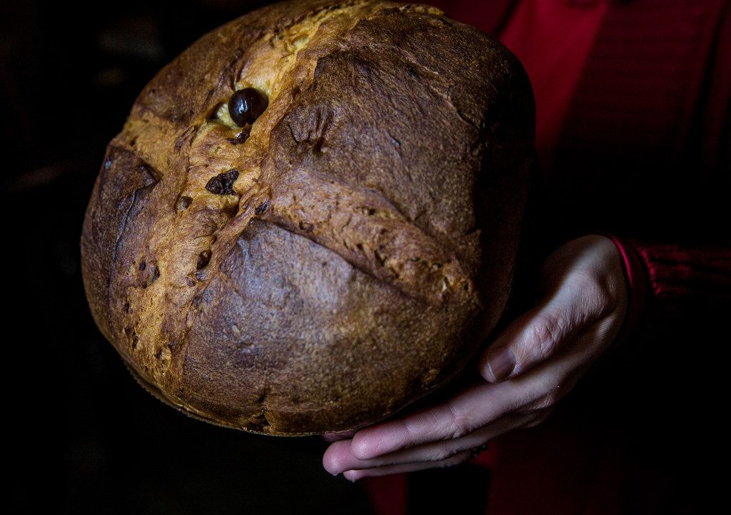 Employee Mila Alvarado holds a panettone at Jimmy's Food Store.
