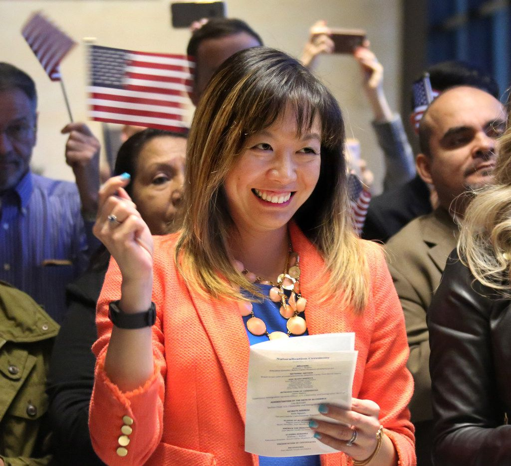 Aura Yanita Ruotolo of Indonesia is all smiles as she's sworn in as a U.S. citizen in Fort Worth in late 2017. In Dallas, immigrants account for almost 32 percent of the workforce.