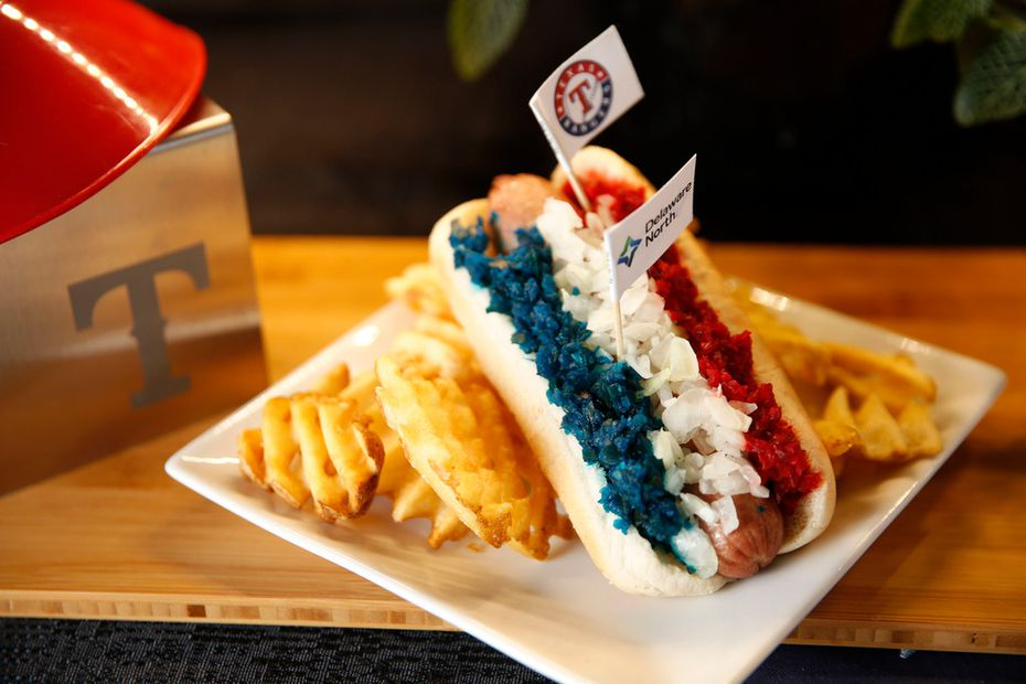 The RWB (Red White & Blue) Dog, using Best Maid Pickles, a combination of savory, sweet and spicy Glorious Gherkins relish on a Texas Chili all beef hot dog served with Lays chips, photographed at Globe Life Park in Arlington Texas on Monday, March 25, 2019. (Rose Baca/Staff Photographer)