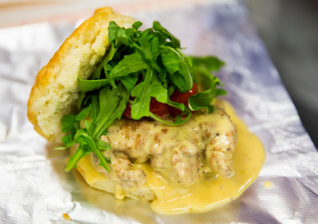 The Saucy Wisconsin sandwich, made up of fried chicken in creamy cheese sauce with cherry sweet piquant peppers and arugula on a biscuit, on Thursday, March 30, 2017 at Rise Biscuits Donuts in Allen, Texas. (Ashley Landis/The Dallas Morning News)