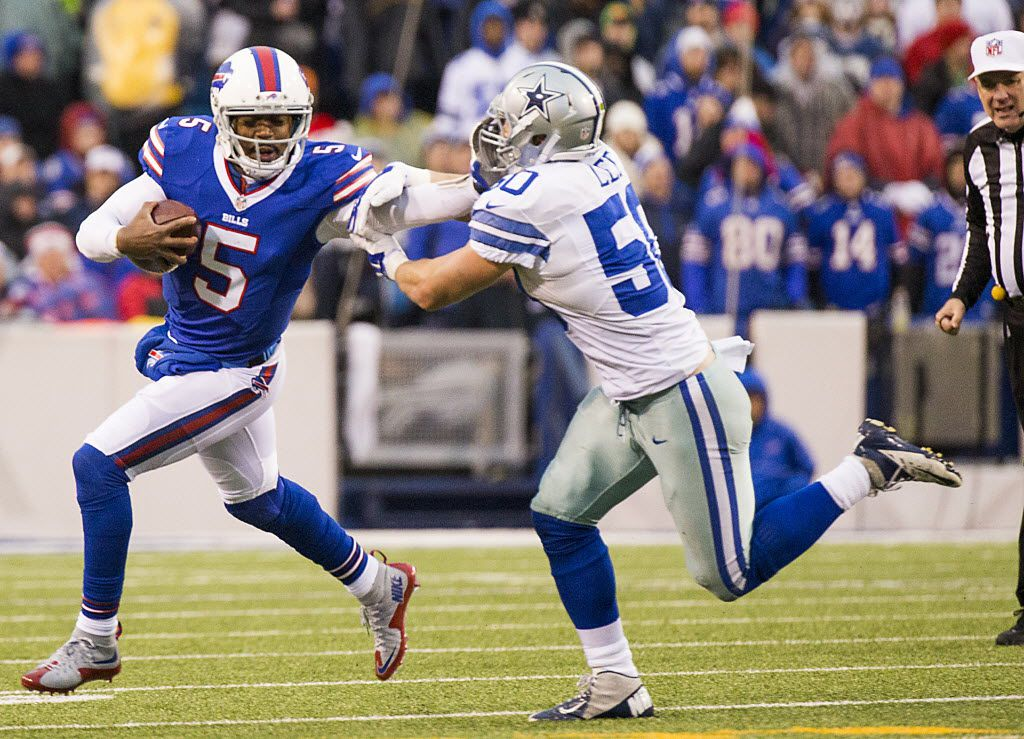 Buffalo Bills quarterback Tyrod Taylor (5) commits a facemask penalty against Dallas Cowboys outside linebacker Sean Lee (50) during the first half of an NFL football game at Ralph Wilson Stadium on Sunday, Dec. 27, 2015, in Orchard Park, N.Y. (Smiley N. Pool/The Dallas Morning News)