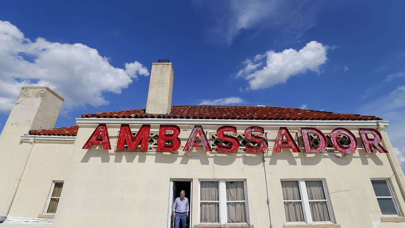 Developer Jim Lake Jr. steps out onto the roof of the historic Ambassador Hotel south of downtown Dallas.