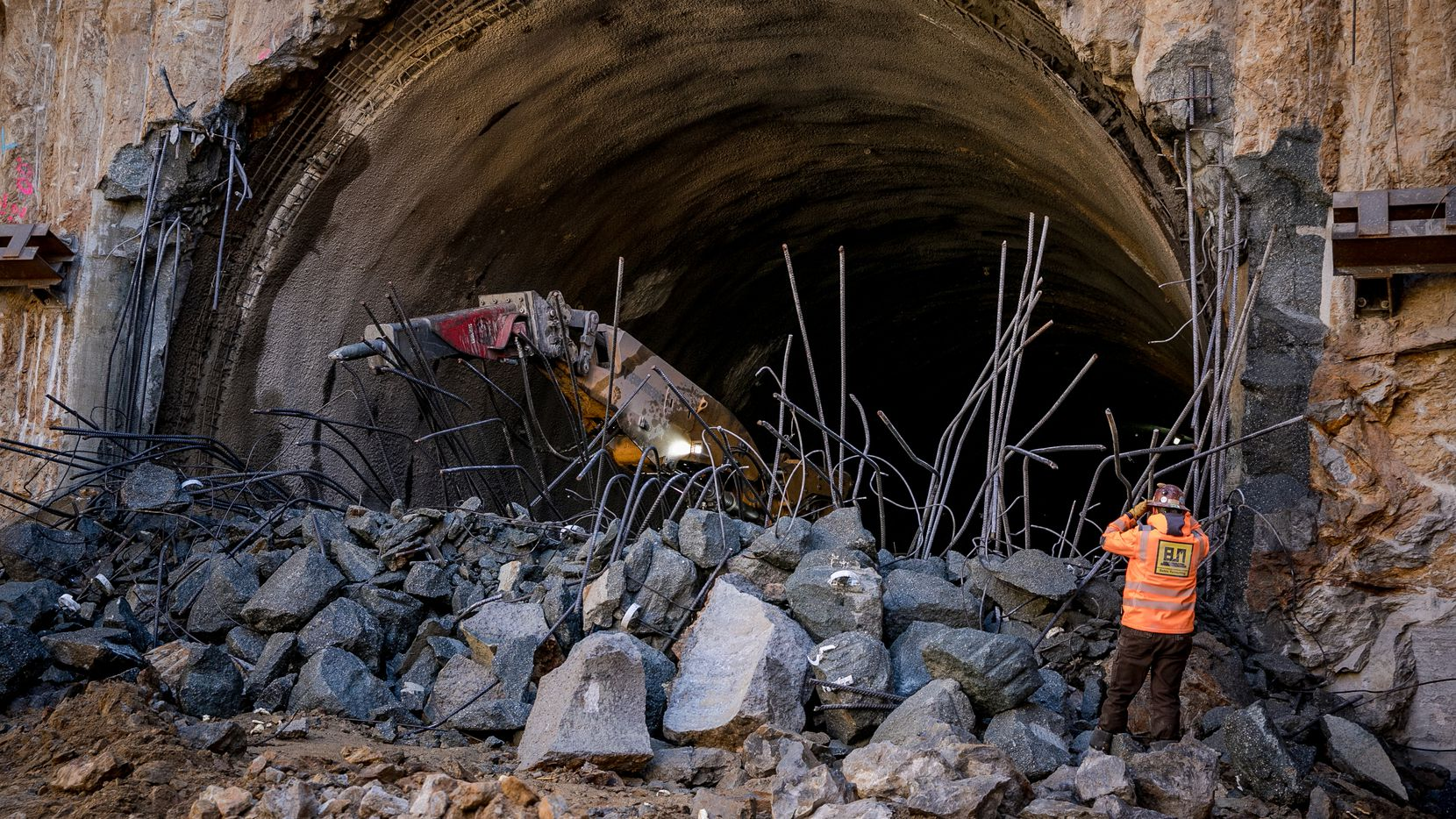 Workers break through the end of a tunnel for Maryland's Purple Line, which is already running a year late with $300 million in cost overruns. Fluor Corp. of Irving, which is leading the design-build team, recently took a financial charge on the project.