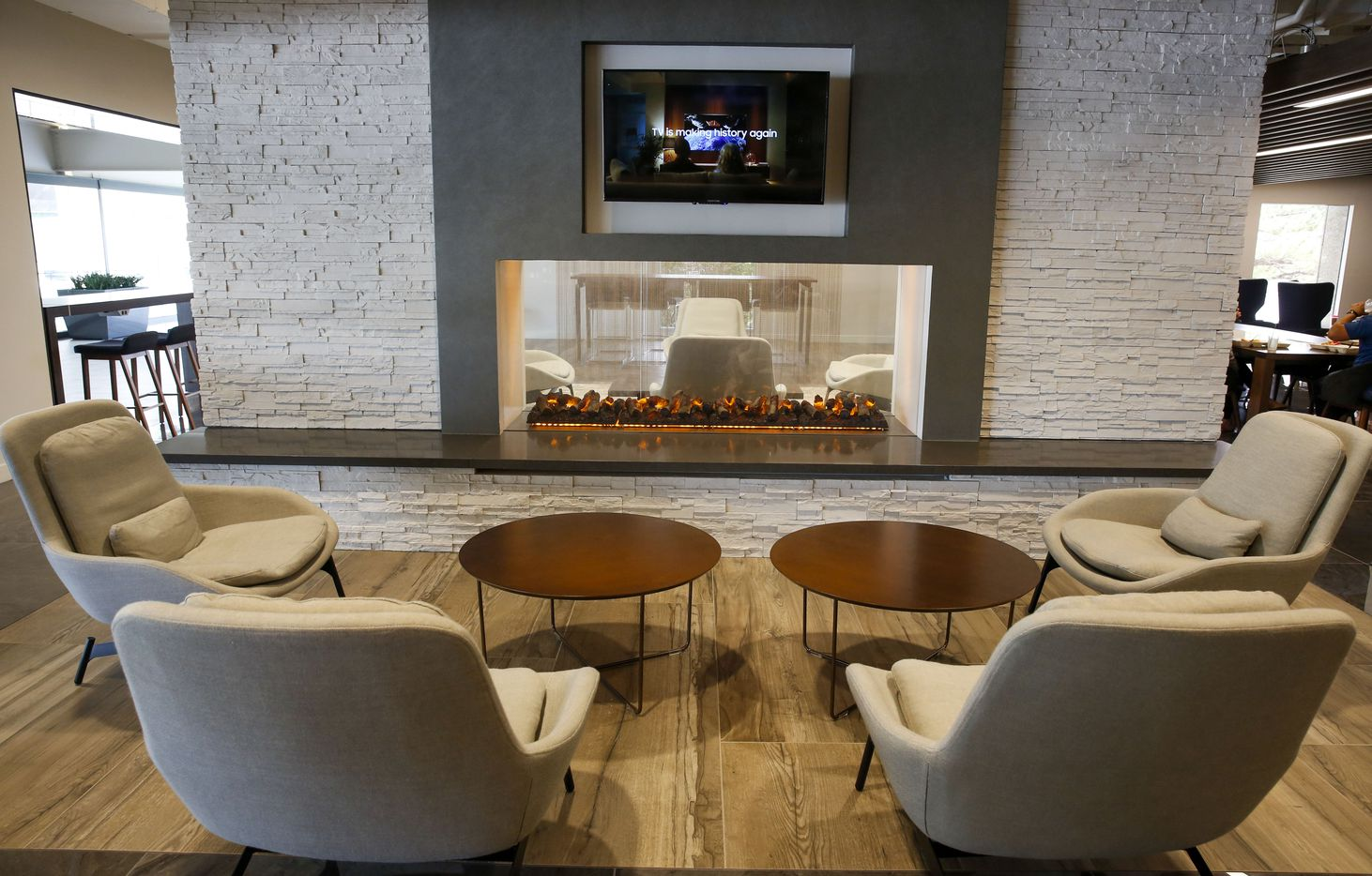A lounge area in front of a fireplace in the tenant lounge in The Towers at Williams Square.