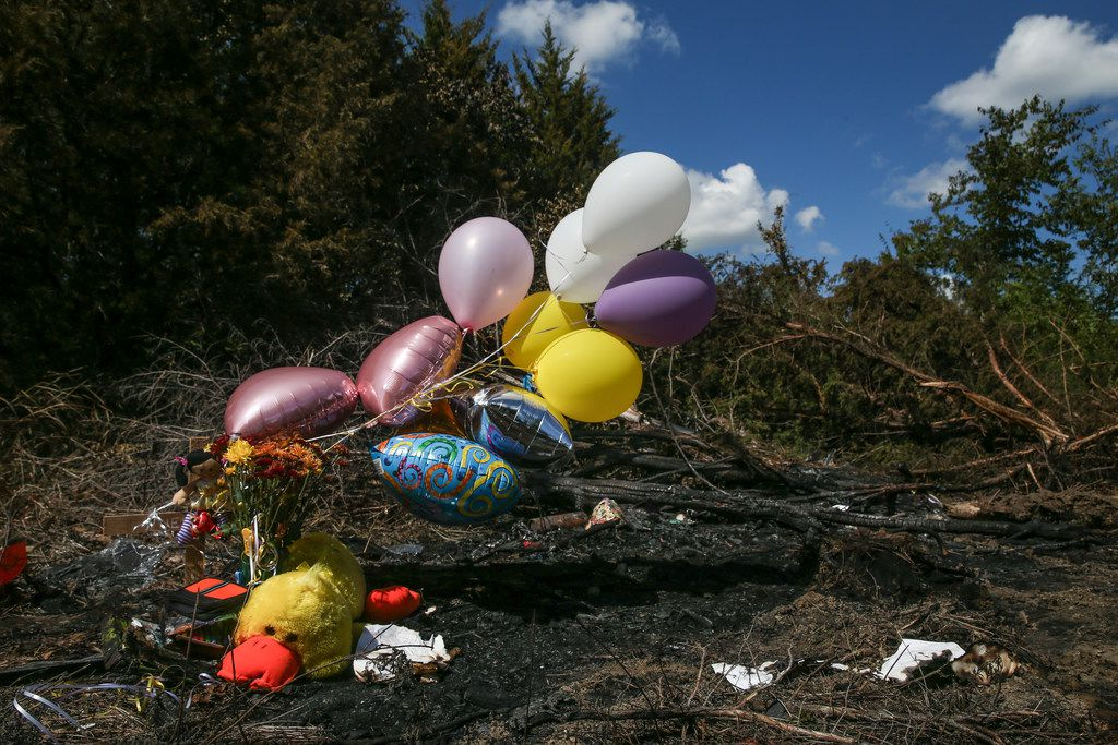 A makeshift memorial grew at the site where a 12-year-old girl died Wednesday when a Mesquite ISD school bus rolled into a ditch with more than 40 students on board.