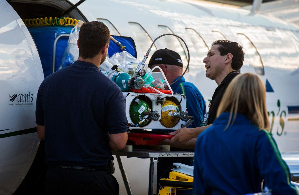 Paramedics transport one of ten babies in a Neonatal Intensive Care Unit from a Cook Children's Hospital airplane to an ambulance on Thursday, August 24, 2017 at Teddy Bear Transport hanger at Fort Worth Meacham Airport in Fort Worth, Texas. The babies were evacuated from Driscoll Children's Hospital in Corpus Christi ahead of Hurricane Harvey. (Ashley Landis/The Dallas Morning News)