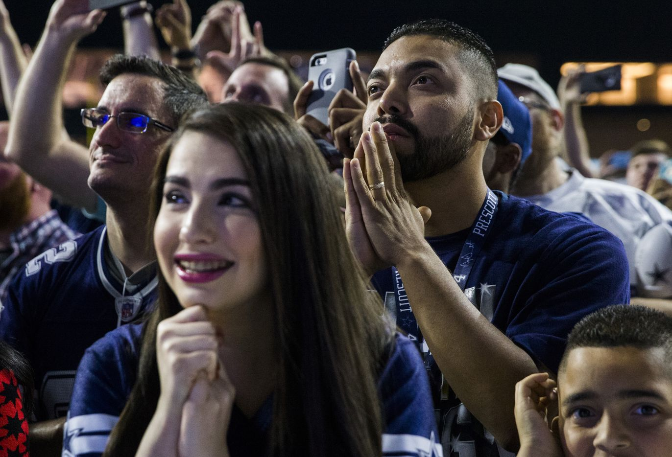 Dallas Cowboys fans Amber Williams and Jose Umanzor wait to hear the Cowboys' pick during the Dallas Cowboys' 2017 NFL Draft Party on Thursday, April 27, 2017, at The Star in Frisco.
