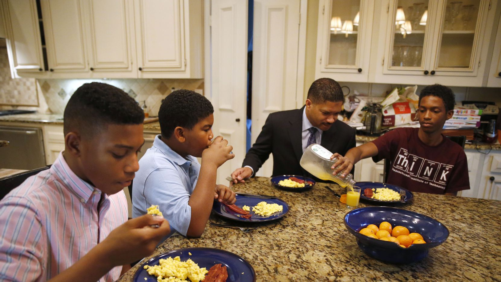 From left, William Waters, Christopher Waters, James Waters and Joshua Waters eat breakfast at their home in Dallas before heading off to school. (Vernon Bryant/Staff Photographer)