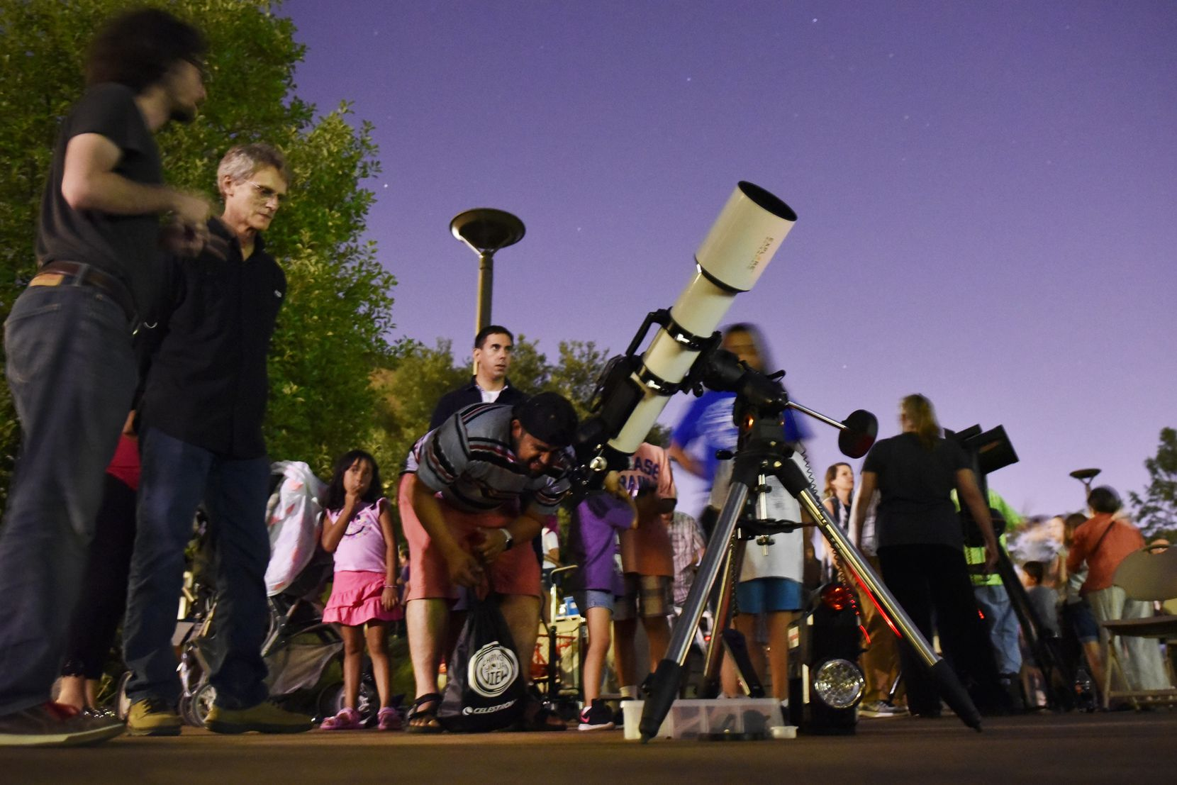 Felipe Cuellar, 36, of Dallas, views the planet Saturn through a telescope during a Mars viewing event hosted by the Texas Astronomical Society of Dallas at Brookhaven College July 31, 2018.