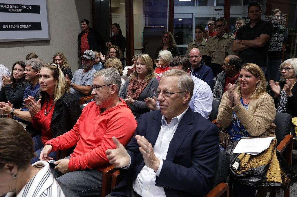 Citizens applaud an announcement to cancel annexation plans during a council meeting at City Hall in McKinney, TX, on Nov. 7, 2017. (Jason Janik/Special Contributor)