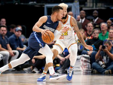 Dallas Mavericks guard Jalen Brunson (13) dribbles past Golden State Warriors guard Ky Bowman (12) during the fourth quarter at the American Airlines Center in Dallas, Wednesday, November 20, 2019. (Tom Fox/The Dallas Morning News)