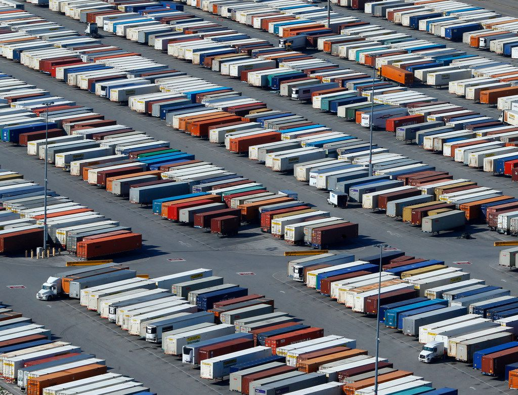 Texas companies are starting to feel the impact of President Donald Trump's trade war in real dollars. A new analysis shows that they paid $654 million more in tariffs this summer than last summer, a finding that reflects Texas' trade-heavy economy. This photo shows cargo containers near Alliance Airport in Fort Worth.