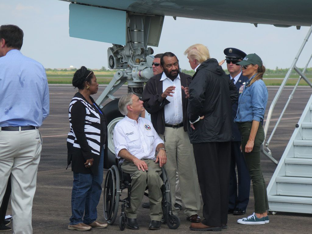 President Donald Trump speaks with U.S. Rep. Al Green, D-Houston, who has called for impeachment of the president, on the tarmac at Ellington Field in Houston on Sept. 2, 2017. Trump and first lady Melania Trump visited Houston to survey Hurricane Harvey damage.