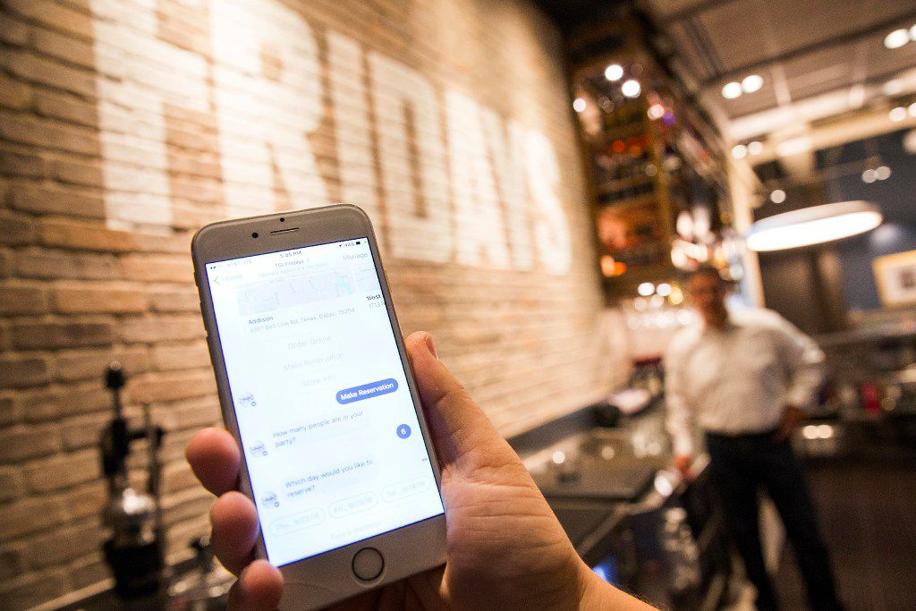 Ben Lamm, CEO / Co-Founder of Conversable, demonstrates a message thread using Facebook Messenger to interact with a chatbot his company has developed for TGI Fridays at the restaurant chain's corporate offices on Thursday, Sept. 22, 2016, in Dallas. (Smiley N. Pool/The Dallas Morning News)