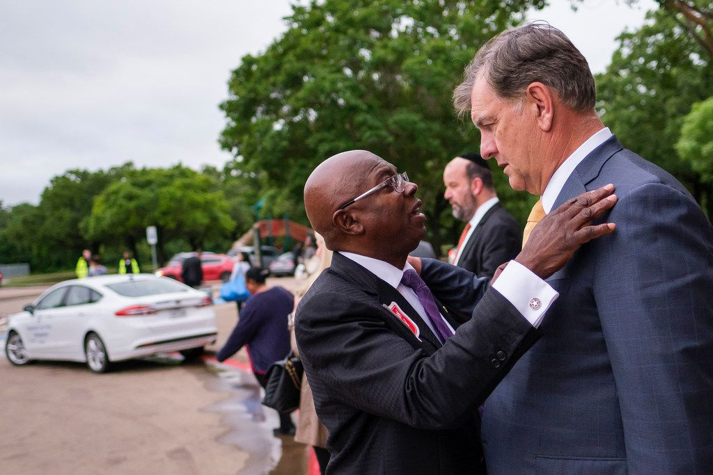 Dallas Mayor Mike Rawlings talks with council member Tennell Atkins after an offsite City Council meeting at the Kleberg-Rylie Recreation Center  on May 8, 2019, in Dallas. (Smiley N. Pool/The Dallas Morning News)