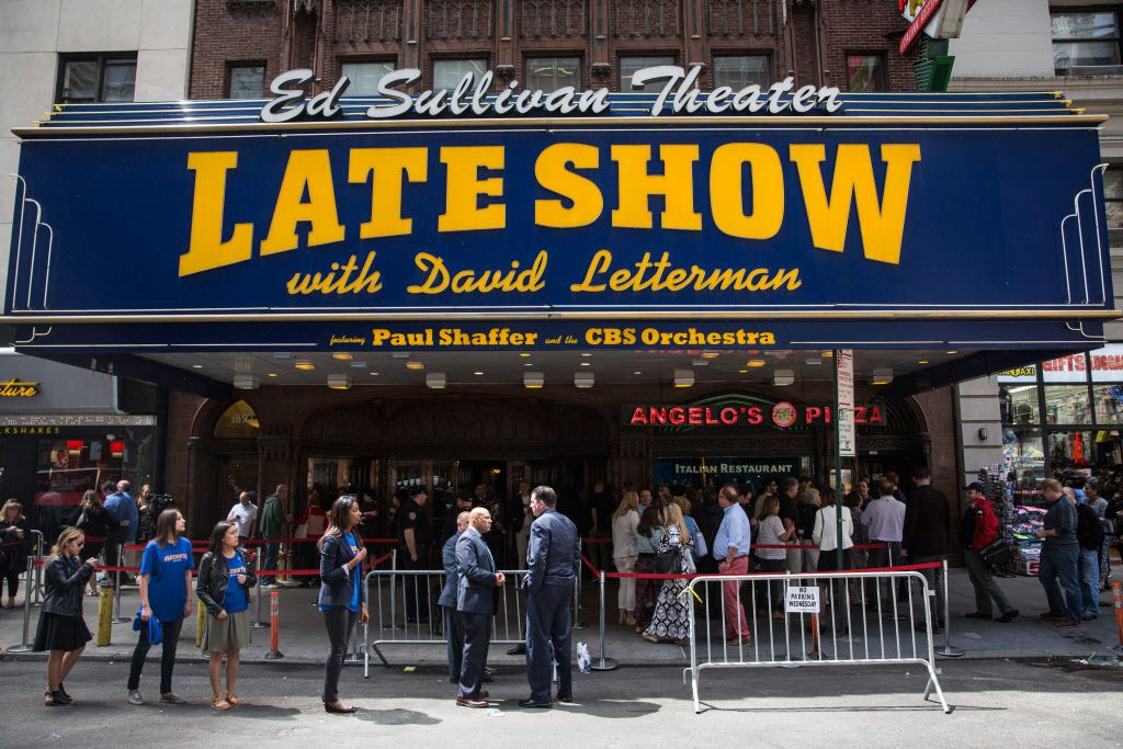 Fans of David Letterman, members of the media, security agents, passersby and employees of the Late Show gather around the entrance to the Ed Sullivan Theater on Wednesday before the final taping.