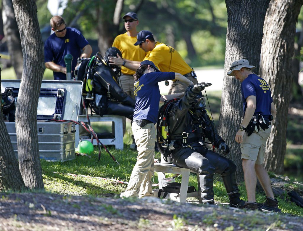 FBI diversgot ready to search an area of Turtle Creek for evidence on Wednesday. (Jae S. Lee/Staff Photographer)