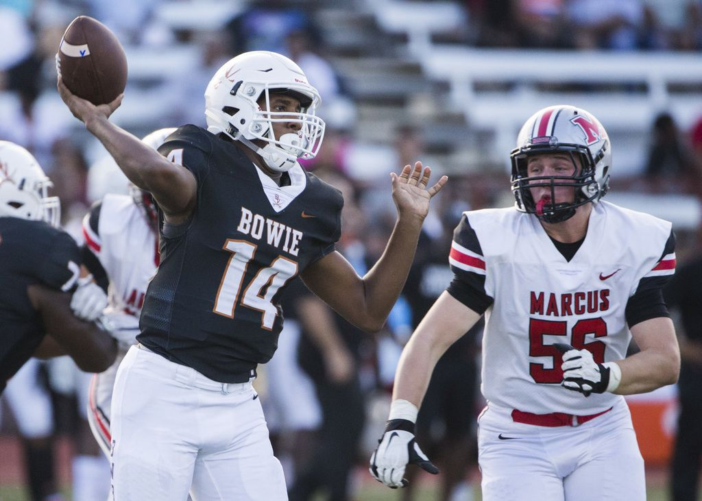 Arlington Bowie quarterback Drevvon Ponder (14) throws  a pass ahead of Flower Mound Marcus defensive lineman Max Walstad (56) during the first quarter of a high school football game between Flower Mound Marcus and Arlington Bowie on Thursday, August 29, 2019 at Wilemon Field in Arlington. (Ashley Landis/The Dallas Morning News)