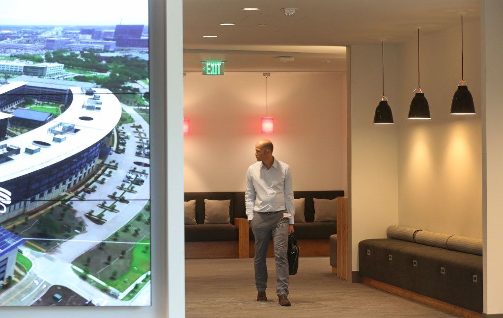 The media tours the facility at the grand opening of the Toyota headquarters in Plano, Texas, photographed on Thursday, July 6, 2017. (Louis DeLuca/The Dallas Morning News)