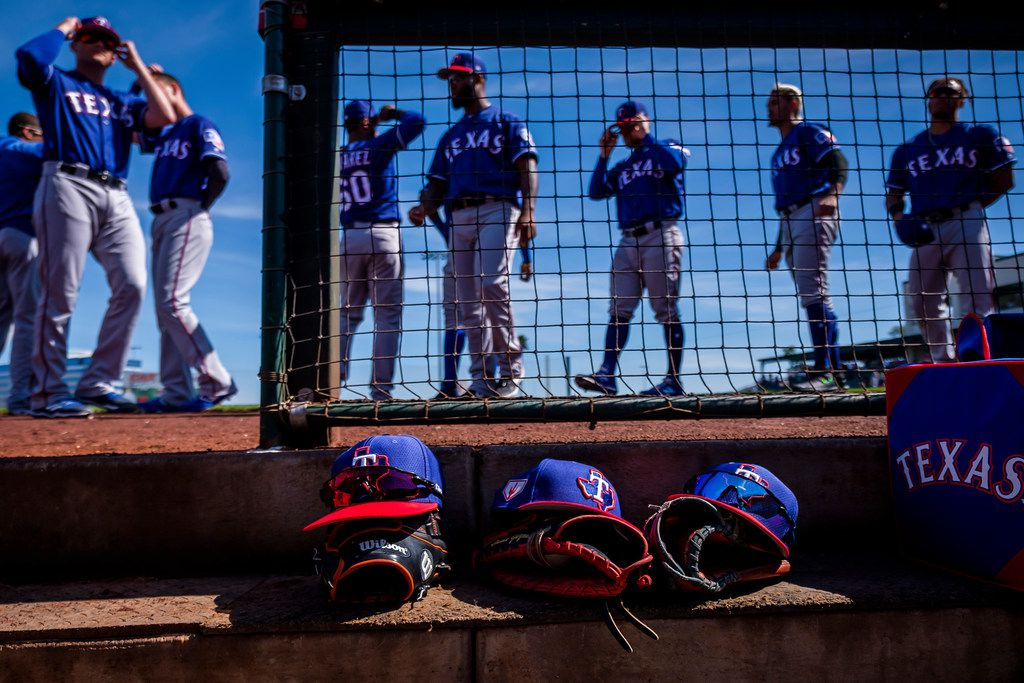 Texas Rangers players prepare to take the field  before a spring training baseball game against the Los Angeles Angels on Thursday, Feb. 28, 2019, in Tempe, Ariz.. (Smiley N. Pool/The Dallas Morning News)