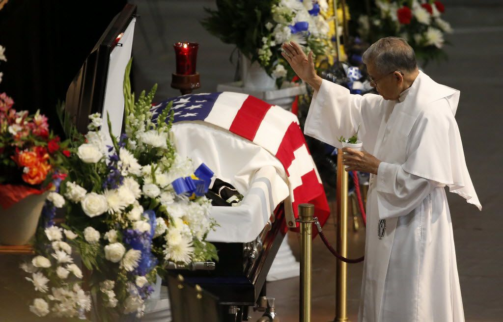 Rev. Stephen Jasso blesses the casket of fallen Dallas police officer Patrick Zamarripa at Wilkerson-Greines Activity Center in Fort Worth, Friday, July 15, 2016. Officer Patrick Zamarripa was one of five police officers killed by last week's ambush attack in Dallas. (Pool photo Jae S. Lee/The Dallas Morning News)