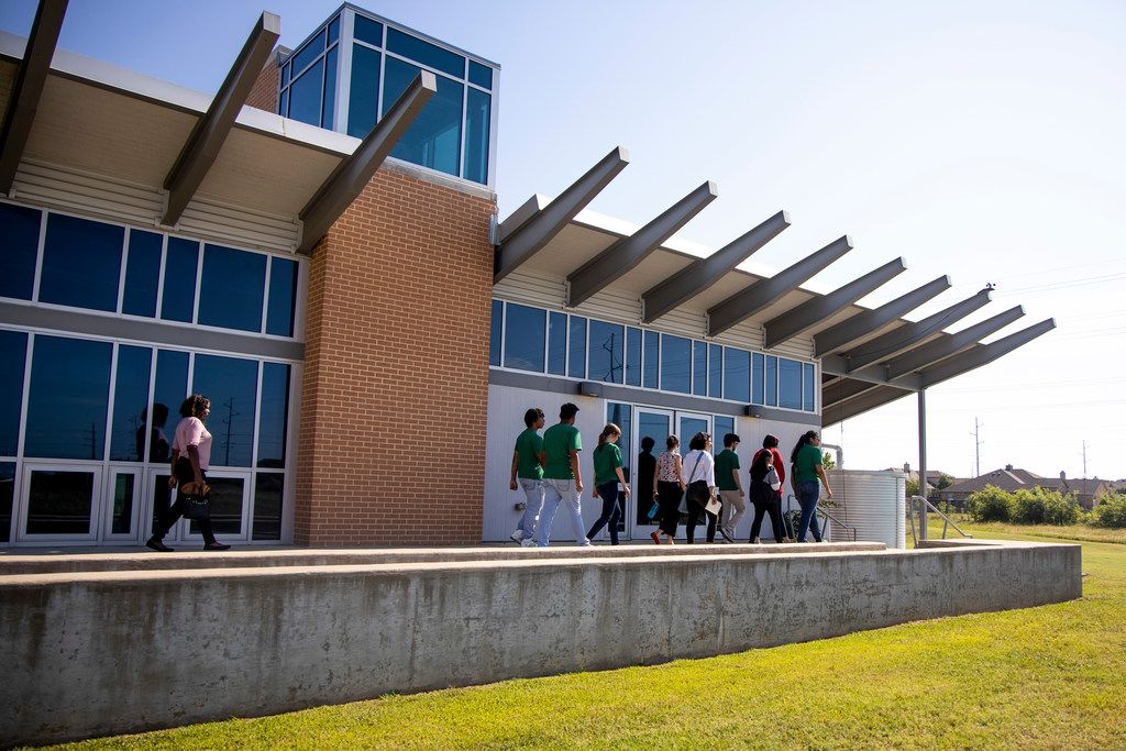 Students tour the University of North Texas Zero Energy Lab in Denton, Texas on Thursday, July 11, 2019. Ruthanne 'Rudi' Thompson, a professor at UNT, works with local teachers and students to encourage water conservation. The program hopes to teach students about conservation and give them a look into what it is like to an environmental researcher.