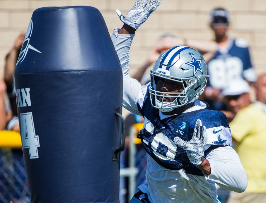 Dallas Cowboys defensive end Robert Quinn (58) attacks a dummy during an afternoon practice at training camp in Oxnard, California on Thursday, August 1, 2019.