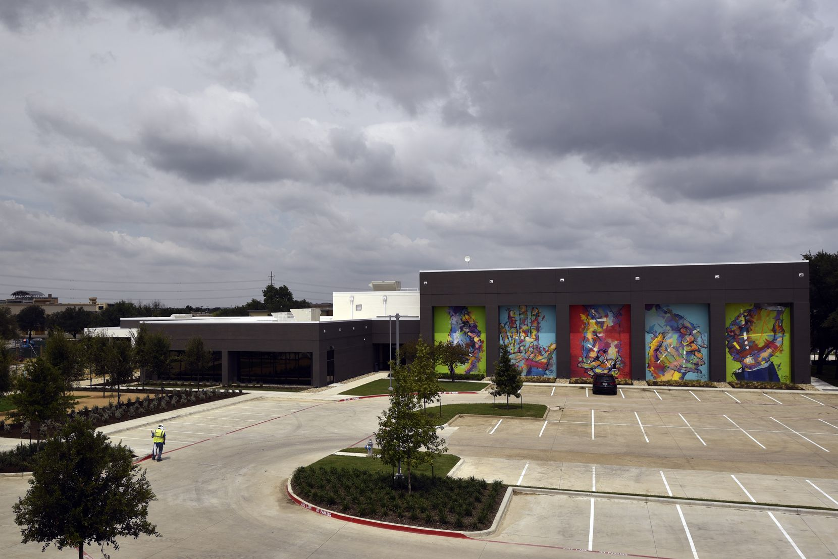 Murals by the Spanish artist Adrian Torres decorate the fitness cente on the Legacy Central campus in Plano.
