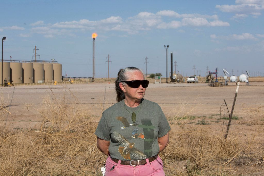 Suzanne Franklin stands near her home in Reeves County, West Texas, on April 11, 2018. Some mornings Franklin wakes with a nose full of dried blood, her voice filled with gravel. Her husband Jim suffers from respiratory problems, too. Complaints like hers are common among people who live near gas sites, academic research has found. Flares burning off gas spew pollutants that assault the respiratory system.