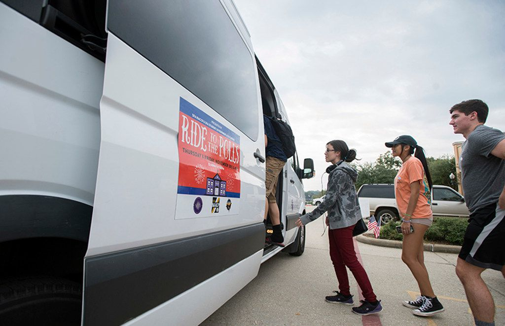 Young voters file onto a shuttle provided by Stephen F. Austin State University'€™s Student Government Association outside the Nacogdoches County Courthouse Annex on Nov. 4, 2016, after casting their ballots on the last day of early voting for Texas. (Tim Monzingo/The Daily Sentinel via AP)